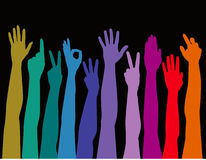 Colorful arms raised up Stock Photos