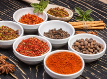 Colorful aromatic Indian spices and herbs on an old oak wooden deep blue board Stock Photography