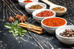 Colorful aromatic Indian spices and herbs on an old oak wooden deep blue board Stock Images