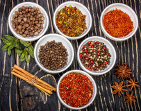 Colorful aromatic Indian spices and herbs on an old oak wooden deep blue board Stock Photo