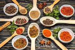 Colorful aromatic Indian spices and herbs on an old oak wooden deep blue board Stock Image