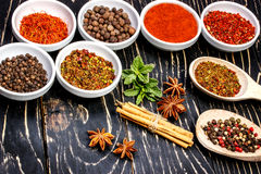 Colorful aromatic Indian spices and herbs on an old oak wooden deep blue board Royalty Free Stock Photography