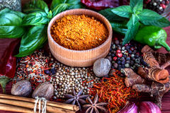 Colorful aromatic spices and herbs on a wooden brown backgrownd Royalty Free Stock Images