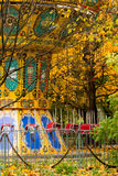 A colorful сarousel in amusement park. Royalty Free Stock Image