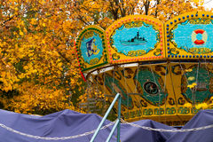 A colorful сarousel in amusement park. Royalty Free Stock Photos