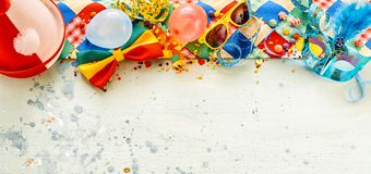 Colorful array of festival or carnival accessories. Colorful array of festival and carnival accessories forming a top border on a wide angle panorama with copy royalty free stock images
