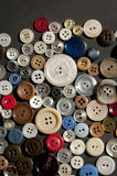 Colorful array of large and small scattered buttons royalty free stock image