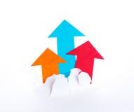 Arrowheads move upward and break paper Royalty Free Stock Photo