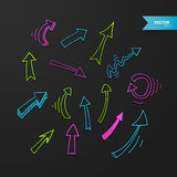 Colorful arrows set on dark background Royalty Free Stock Photos