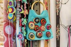 Colorful art bag in a souvenir shop Stock Image