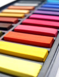 Colorful art pastels in box Stock Photography