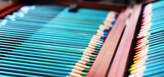 Colorful art pencils in a wooden case Royalty Free Stock Photography