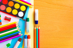 Colorful art supplies on a school desk Stock Images