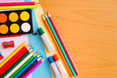 Colorful art supplies on a school desk Stock Photography