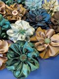 Colorful artificial fabric flowers royalty free stock photo