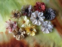 Colorful artificial fabric flowers. Brooch Royalty Free Stock Images