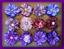 Colorful artificial fabric flowers Stock Images