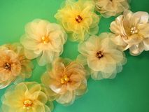 Colorful artificial fabric flowers Stock Photo