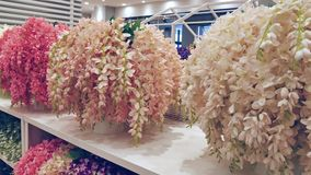 Colorful artificial flowers decoration. stock video footage