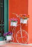 Colorful artificial flowers on decorative bicycle Stock Photo