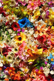 Colorful artificial flowers - floral background royalty free stock photos