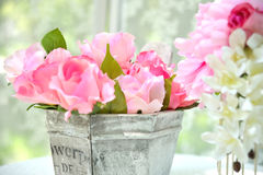 Colorful artificial flowers and leaves Royalty Free Stock Photos
