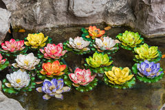 Colorful artificial lotus in the in the pond Stock Photography