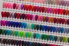 Colorful artificial nails on shelves. In beauty shop Royalty Free Stock Photo