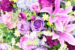 Colorful of artificial plastic and fabric flowers Royalty Free Stock Photos