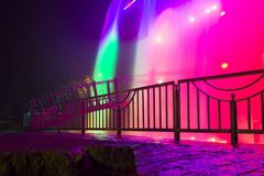 Colorful artificial waterfall at night. Long exposure Royalty Free Stock Image