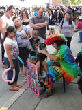 Colorful artist doing face paint for child Stock Photo