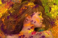 Colorful artistic portrait woman in paint Stock Photos