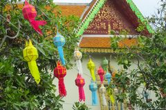 Colorful asian lantern in thai temple pagoda. Traditional red asian chinese culorful lantern in the courtyard of a Buddhist chinese temple. Textile and paper Stock Photos