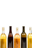 Colorful Assorted Bottles of Wine. Isolated on a White Background royalty free stock images