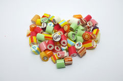 Colorful assorted candies. Colourful assorted candies in heart shape Royalty Free Stock Photography