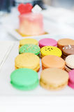 Colorful assorted macaroons. On white table background Stock Images