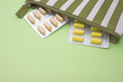 Colorful assorted pharmaceutical tablets and capsules. White beige and yellow pills. Medical conceptual photo, pharmacy theme. Royalty Free Stock Image