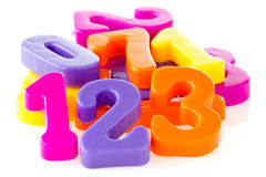 Colorful assorted plastic numbers Royalty Free Stock Images