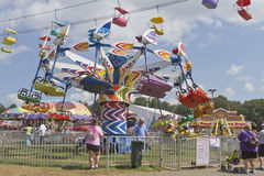 Colorful Assortment of Rides and People at the Mountain State Fa Stock Photography