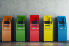 Colorful ATM in concrete interior Stock Image