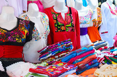 Colorful authentic Mexican women blouses on manekens at the mark Stock Image