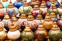 Colorful authentic and traditionally handmade lanterns, chandeliers or mosaic lamps selling on the Turkish Grand Bazaar in Istanbu. L, Turkey. Turkish or Stock Photo