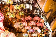 Colorful authentic and traditionally handmade lanterns, chandeliers or mosaic lamps selling on the Turkish Grand Bazaar in Istanbu. L, Turkey. Turkish or Stock Images