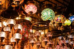 Colorful authentic and traditionally handmade lanterns, chandeliers or mosaic lamps selling on the Turkish Grand Bazaar in Istanbu. L, Turkey. Turkish or Stock Photography