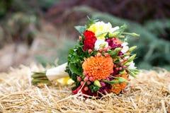 Colorful autumn bouquet closeup. Colorful autumn wedding bouquet closeup On blurred background Stock Photography