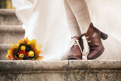Colorful autumn bouquet and two women legs with le stock image