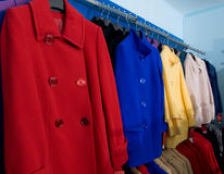 Colorful autumn female  coats in shop Stock Photography