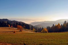 Colorful Autumn Landscape. Beautiful, misty autumn scenery in the mountain Stock Images