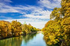 Colorful autumn landscape of Isar river in Munich, Bavaria royalty free stock image