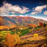 Colorful autumn landscape in mountain village. Stock Photo